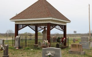 Braz Langley's gravestone and pavilion is located at Ellis Prairie Cemetery in Ellis Prairie, Texas County, Missouri. Braz Langley stipulated in his will how he wanted his grave and provided funds for the upkeep